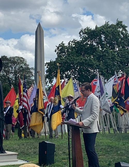 Michael Crowder standing at a lectern in Green-Wood Cemetery